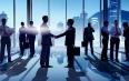 Silhouettes of Businessmen Having a Handshake